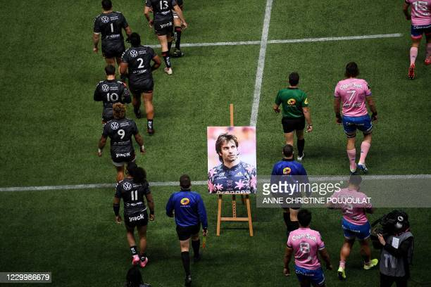 Toulon and Stade Français' players arrive on the pitch to pay tribute to late French player Christophe Dominici prior to the start of the French Top...