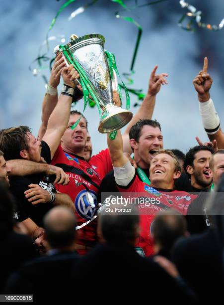 Toulon captain Jonny Wilkinson lifts the trophy with team mates after the Heineken Cup final match between Clermont Auvergne and Toulon at Aviva...