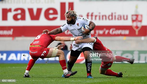 Toulon centre Mathieu Bastareaud makes a break during the European Rugby Champions Cup match between Scarlets and RC Toulonnais at Parc Y Scarlets on...