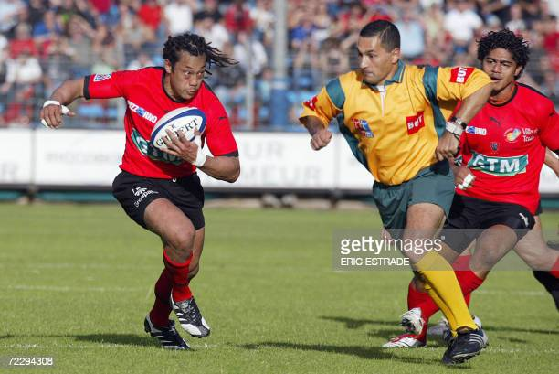 Former New Zealand rugby union national team captain Tana Umaga runs with the ball with the second division French rugby union club of Toulon, during...