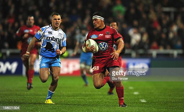 Toulon number 8 Chris Masoe races away from Mark Jennings of Sale during the Heineken Cup match between Sale Sharks and Toulon at Salford City...