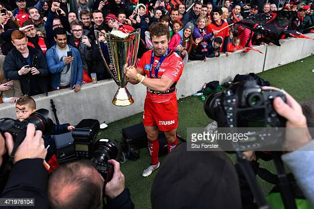 Toulon player Leigh Halfpenny celebrates with the trophy after the European Rugby Champions Cup Final between ASM Clermont Auvergne and RC Toulon at...