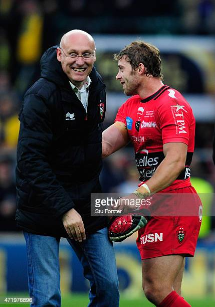 Toulon player Leigh Halfpenny is congratulated by coach Bernard Laporte after the European Rugby Champions Cup Final between ASM Clermont Auvergne...