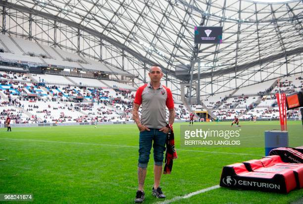 RC Toulon rugby union fan Cedric Abellon poses prior to the French Top 14 rugby union match between RC Toulon and Montpellier on April 14 2018 at the...