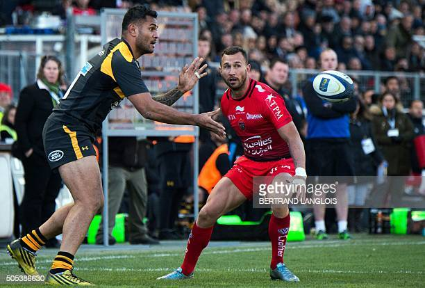 RC Toulon's Australian flyhalf Quade Cooper vies with Wasps' New Zealander winger Frank Halai during the European Champions Cup rugby union match RC...