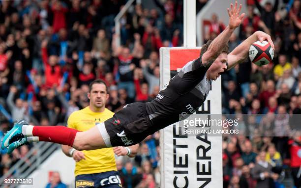 Toulon's British winger Chris Ashton dives to score a try during the French Top 14 rugby union match RC Toulon vs Clermont on March 25 2018 at the...