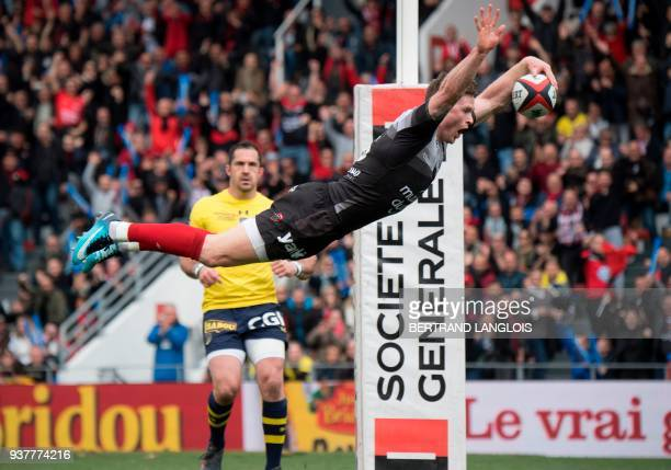 RC Toulon's British winger Chris Ashton dives to score a try during the French Top 14 rugby union match RC Toulon vs Clermont on March 25 2018 at the...
