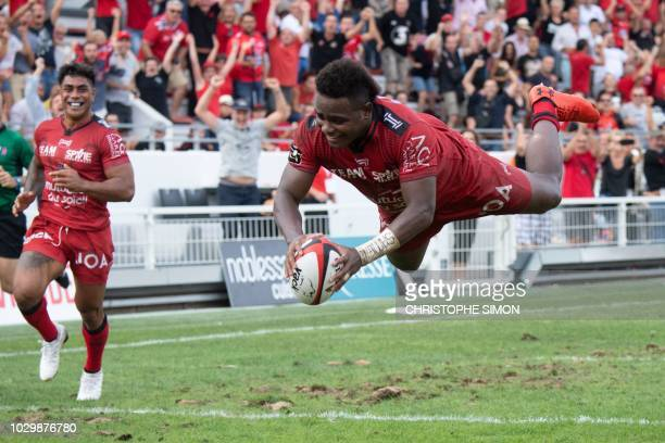 Toulon's Fijian wing Filipo Nakosi dives to score a try during the French Top 14 rugby union match between Toulon and Castres on September 9 at the...