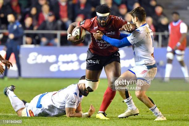 Toulon's Fijian wing Masivesi Dakuwaqa evades tackles during the French Top 14 rugby union match between RC Toulon and Castres Olympique on January 5...