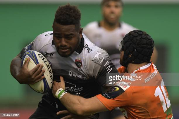 RC Toulon's Fijian winger Josua Tuisova is tackled by Benetton Treviso's Irish fullback Ian McKinley during the European Rugby Champions Cup match...