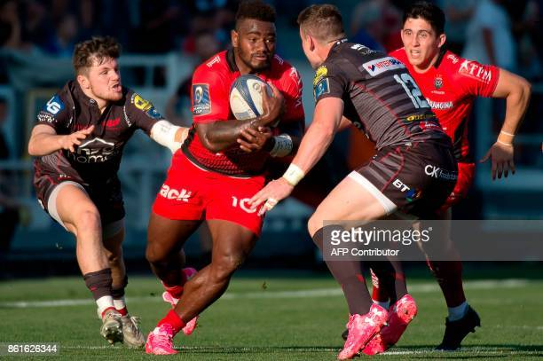 RC Toulon's Fijian winger Josua Tuisova vies with Llanelli's Welsh centre Scott Williams during the European Champions Cup rugby union match between...