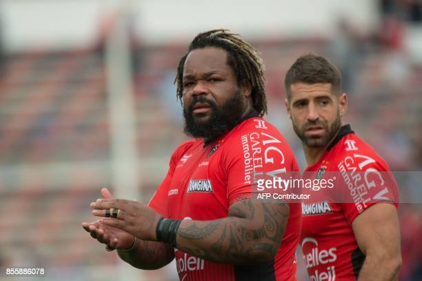 RC Toulon's French centre Mathieu Bastareaud acknowledges the crowd next to RC Toulon's French scrumhalf Sebastien TillousBorde after the French Top...