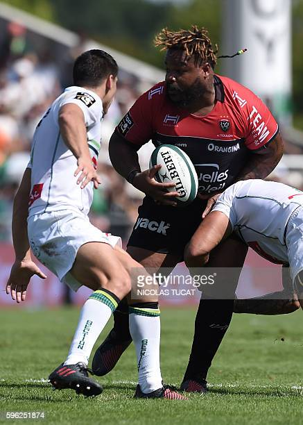 RC Toulon's French centre Mathieu Bastareaud is tackled during the French Top 14 rugby union match between Pau and Toulon on August 27 2016 at the...