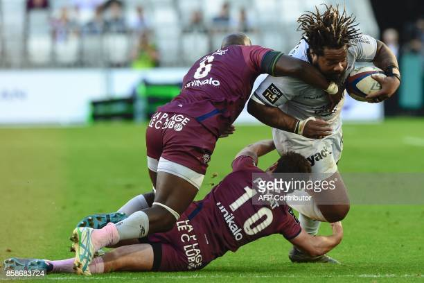 Toulon's French centre Mathieu Bastareaud is tackled during the French Top 14 rugby union match between Bordeaux-Begles and Toulon on October 7, 2017...