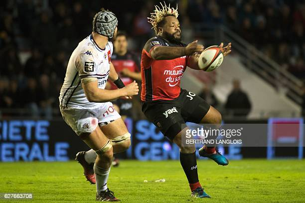 RC Toulon's French centre Mathieu Bastareaud makes a pass during the French Top 14 rugby union match RC Toulon vs Union BordeauxBegles on December 4...