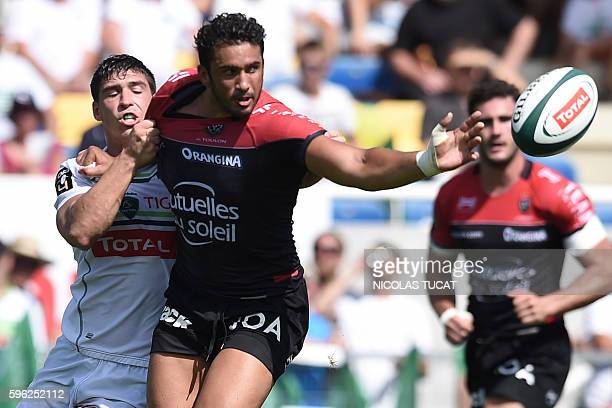RC Toulon's French centre Maxime Mermoz passes the ball during the French Top 14 rugby union match between Pau and Toulon on August 27 2016 at the...