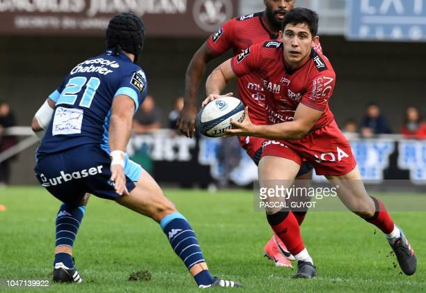 Toulon's French flyhalf Anthony Belleau vies with Montpellier's French center Alexandre Dumoulin during the French Top 14 rugby match between...