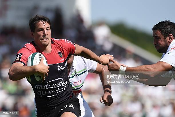 RC Toulon's French flyhalf Francois Trinh Duc runs with the ball during the French Top 14 rugby union match between Pau and Toulon on August 27 2016...