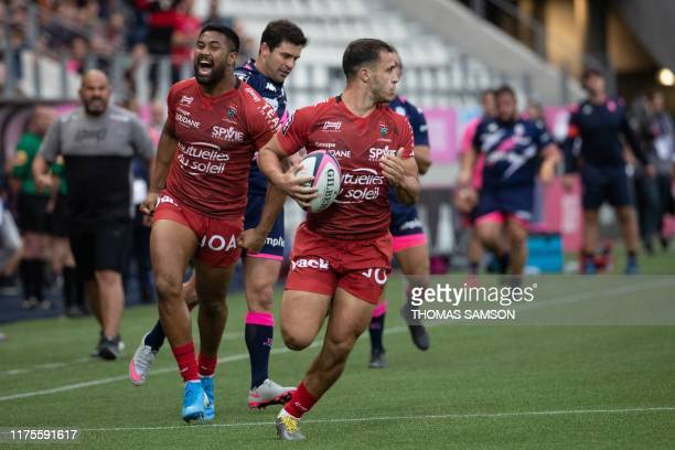 Toulon's French fly-half Mathieu Smaili runs to score a try during the French Top 14 rugby union match between Stade Francais and RC Toulon on...