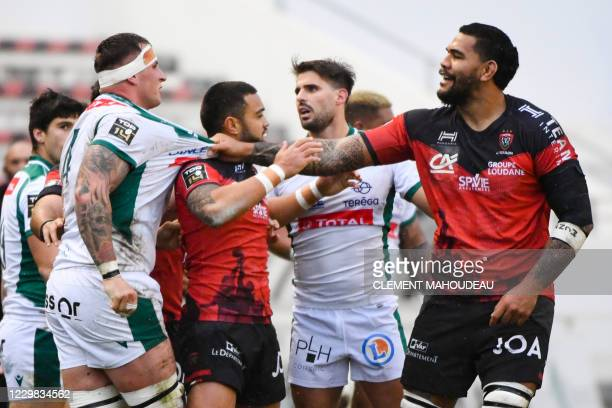 Toulons French lock Romain Taofifenua , argues with Pau's French lock Julien Delannoy during the French Top14 rugby union match between Toulon and...