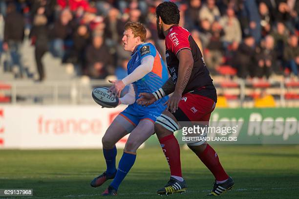 RC Toulon's French lock Romain Taofifenua attempts to tackle Llanelli's flyhalf from Wales Rhys Patchell during the European Rugby Champions Cup...