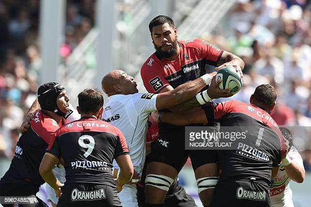 RC Toulon's French lock Romain Taofifenua grabs the ball during the French Top 14 rugby union match between Pau and Toulon on August 27 2016 at the...