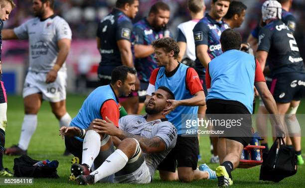 Toulon's French lock Romain Taofifenua is helped by medical staff during the French Top 14 rugby union match between Stade Francais and Toulon at the...