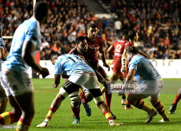 Toulon's French lock Romain Taofifenua vies with Perpignan's Samoa lock Masalosalo Tutaia during the French Top 14 rugby union match between Toulon...