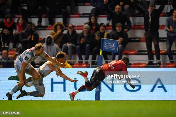 Toulon's French wing Daniel Ikpefan scores a try during the French Top 14 rugby union match between Toulon and Pau on February 23 at the Mayol...