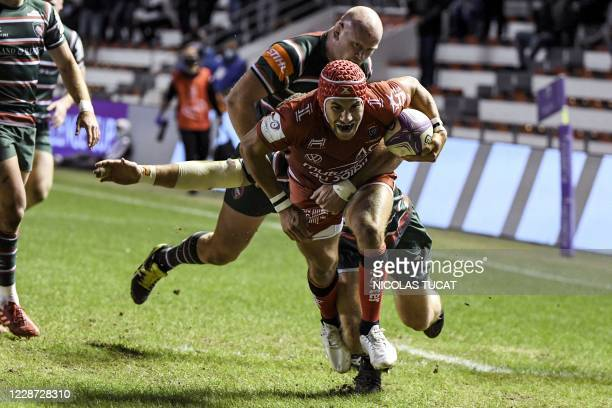 Toulon's French wing Gabin Villiere dives and scores a try during the European Challenge Cup semifinal rugby union match between RC Toulon and...