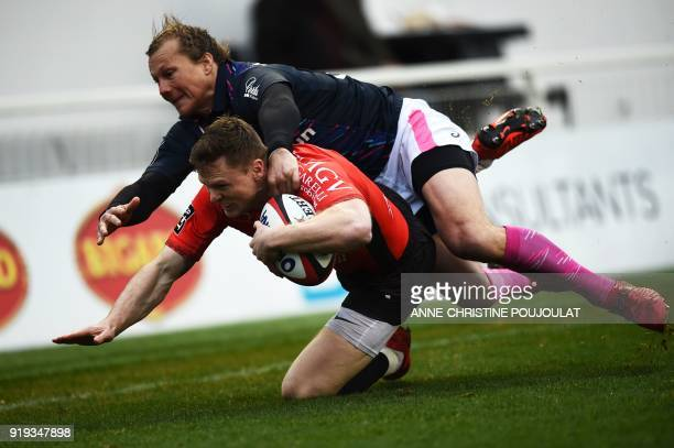 RC Toulon's French winger Chris Ashton scores a try past Stade Français Charl McLeod during the French Top 14 rugby union match Toulon vs Stade...