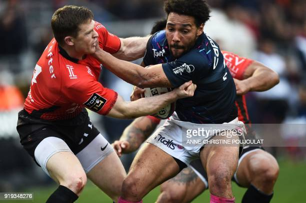 RC Toulon's French winger Chris Ashton vies with Stade Français Jimmy Yobo during the French Top 14 rugby union match Toulon vs Stade Français at The...