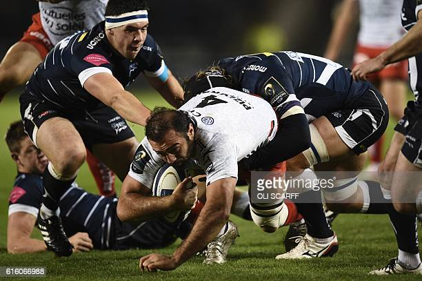 Toulon's Georgian lock Mamuka Gorgodze is tackled during the European Rugby Champions Cup rugby union round 2 match between Sale Sharks and Toulon at...