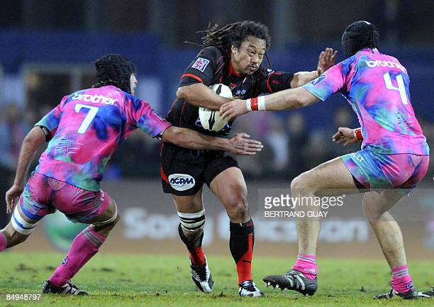 Toulon's manager and Tana Umaga vies with Paris' locks Pierre Rabadan and Arnaud Marchois during their French Top 14 rugby Union match, on February...