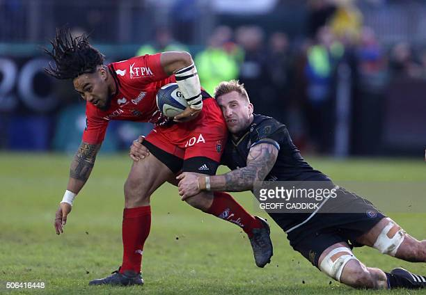 TOPSHOT Toulon's New Zealand centre Ma'a Nonu tackled by Bath's Welsh lock Dominic Day during the European Rugby Champions Cup pool 5 rugby union...