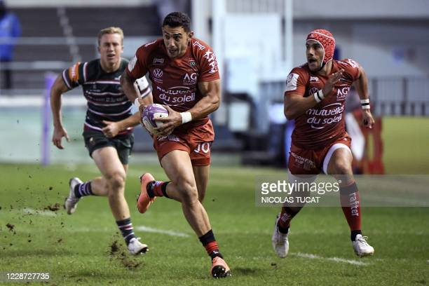 Toulon's New Zealander wing Bryce Heem runs to score a try during the European Challenge Cup semifinal rugby union match between RC Toulon and...