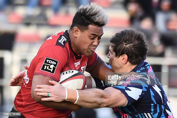 Toulon's New Zealander wing Julian Savea is tackled by Stade Francais' South African flanker Willem Alberts during the French Top 14 rugby union...