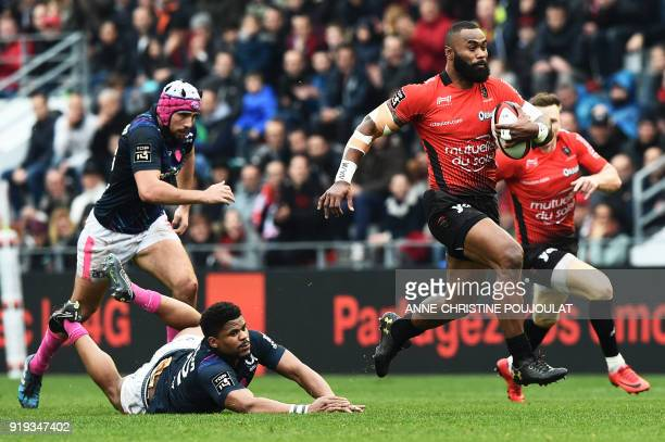 RC Toulon's Semi Radradra runs with the ball away from Stade Français's Lauren Sempéré during the French Top 14 rugby union match Toulon vs Stade...