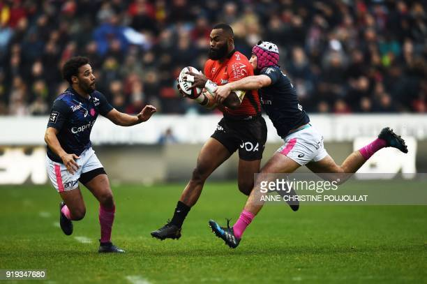 RC Toulon's Semi Radradra vies with Stade Français's Théo Millet during the French Top 14 rugby union match Toulon vs Stade Français at The Mayol...