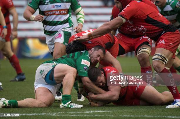 RC Toulon's South African prop Marcel Van Der Merwe vies with Treviso's flyhalf Ian McKinley during the Champions Cup rugby union match RC Toulon vs...