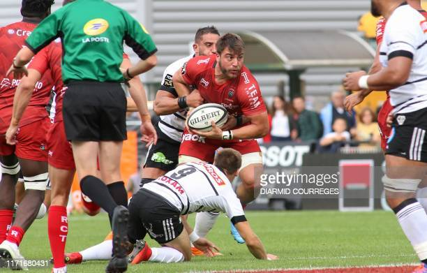 Toulon's South African prop Wilco Louw runs with the ball during the French Top 14 rugby union match between C A Brive and Toulon on September 28 at...
