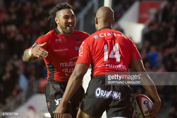 RC Toulon's South African winger JP Pietersen is congratulated by RC Toulon's New Zealander centre Maa Nonu after scoring a try during the French Top...