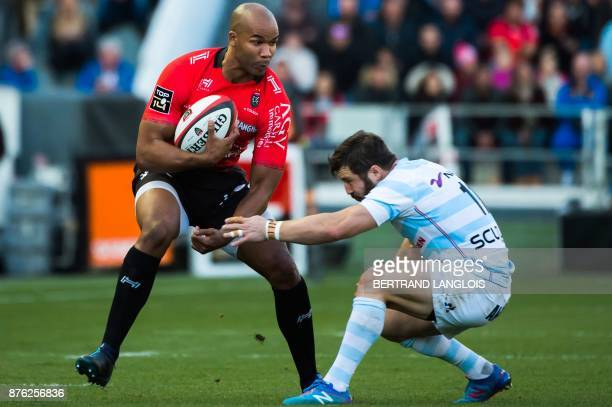 Toulon's South African winger JP Pietersen vies with Racing 92's winger Marc Andreu during the French Top 14 rugby union match RC Toulon vs Racing 92...