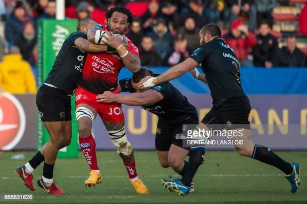 RC Toulon's US Number Eight Samu Manoa is tackled by Bath's players during the Champions Cup rugby union match RC Toulon vs Bath on December 9 2017...