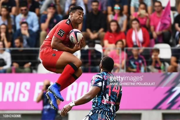 Toulon's wing Julian Savea vies with Stade Francais Paris' Fidjian winger Waisea Nayacalevu Vuidravuwalu during the French Top 14 rugby union match...