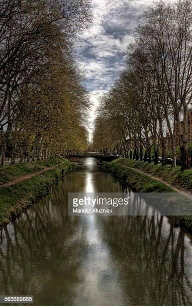 Toulouse Canal du Midi banks, footbridge and trees