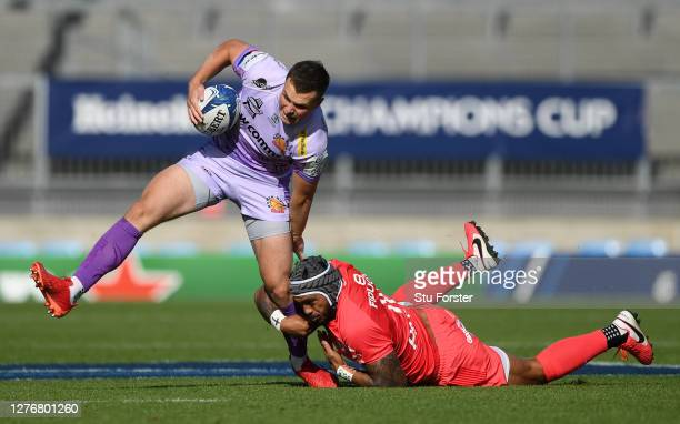 Toulouse centre Pita Ahki attempts to halt the run of Exeter fly half Joe Simmonds during the Heineken Champions Cup Semi Final match between Exeter...