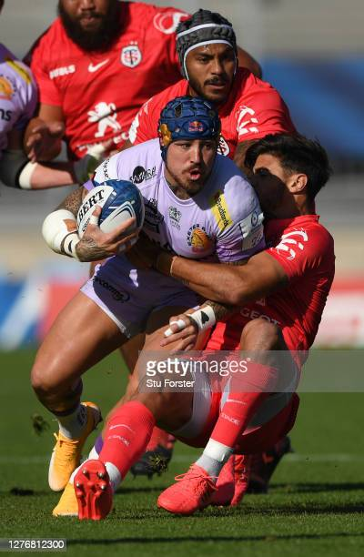 Toulouse fly half Romain Ntamack attempts to halt the run of Exeter wing Jack Nowell during the Heineken Champions Cup Semi Final match between...