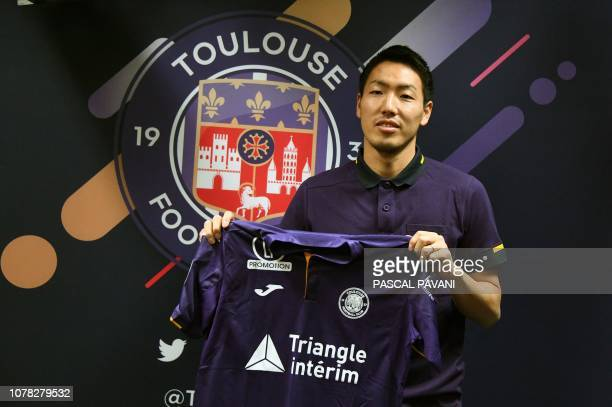Toulouse football club's newly recruited defender Gen Shoji of Japan poses with his new jersey during a press conference in January 6 2019 at the...