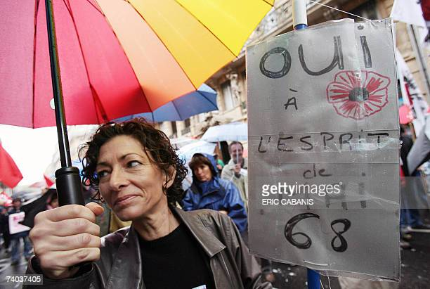 A woman holds up an umbrella during the traditional MayDay demonstration 01 May 2007 in the southwestern French city of Toulouse A few days before...